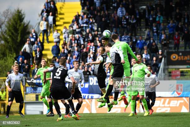 Martin Toshev and Daniel Stanese of Aalen and Enis Hajri and Dustin Bomheuer of Duisburg jump for a header during the third league match between VfR...