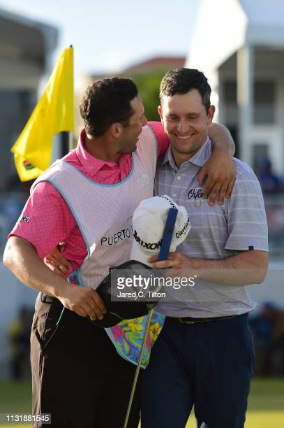 Martin Trainer reacts with his caddie Ryan Ellerbrock following his birdie putt on the 18th green to win the Puerto Rico Open at Coco Beach Golf and...