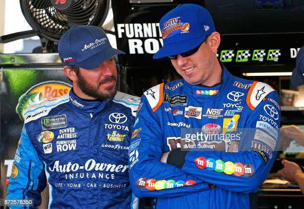 Martin Truex Jr driver aof the AutoOwners Insurance Toyota and Kyle Busch driver of the MM's Caramel Toyota talk during practice for the Monster...