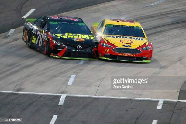 Martin Truex Jr driver of the 5hour ENERGY/Bass Pro Shops Toyota and Joey Logano driver of the Shell Pennzoil Ford race out of turn four on the final...