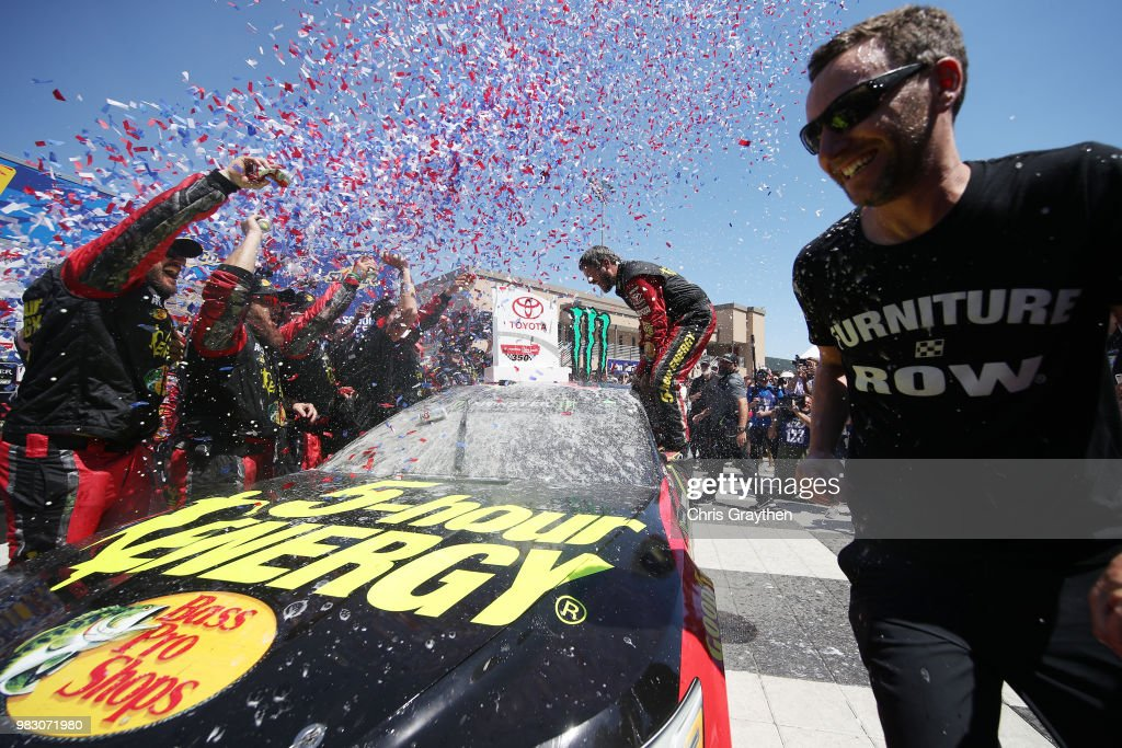 Martin Truex Jr., driver of the #78 5-hour ENERGY/Bass Pro Shops Toyota, celebrates in victory lane after winning the Monster Energy NASCAR Cup Series Toyota/Save Mart 350 at Sonoma Raceway on June 24, 2018 in Sonoma, California.