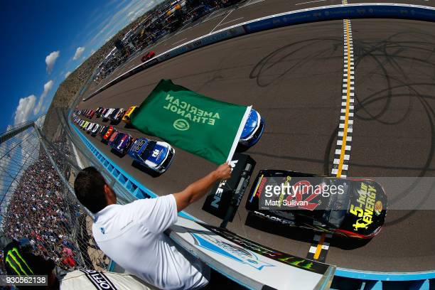 Martin Truex Jr., driver of the 5-hour Energy/Bass Pro Shops Toyota, leads the field at the start of the Monster Energy NASCAR Cup Series...