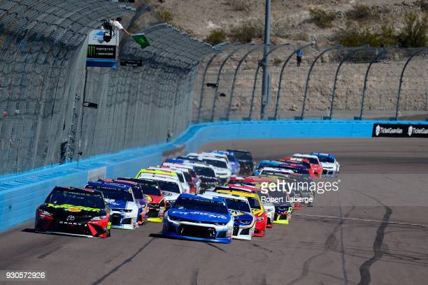 Martin Truex Jr driver of the 5hour Energy/Bass Pro Shops Toyota leads the field past the green flag to start the Monster Energy NASCAR Cup Series...