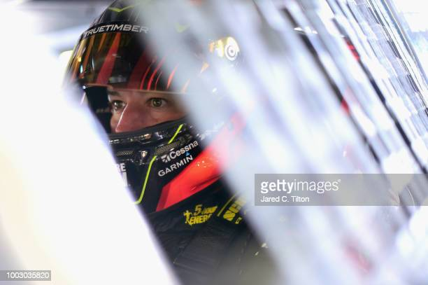 Martin Truex Jr driver of the 5hour ENERGY/Bass Pro Shops Toyota sits in his car during practice for the Monster Energy NASCAR Cup Series Foxwoods...