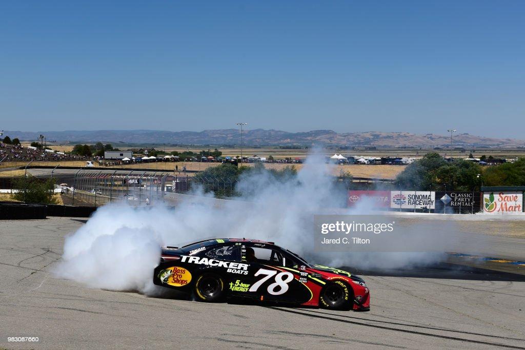 Martin Truex Jr., driver of the #78 5-hour ENERGY/Bass Pro Shops Toyota, celebrates with a burnout after winning the Monster Energy NASCAR Cup Series Toyota/Save Mart 350 at Sonoma Raceway on June 24, 2018 in Sonoma, California.
