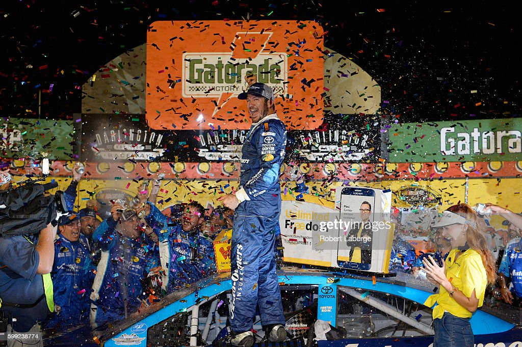Martin Truex, Jr., driver of the #78 Auto-Owners Insurance Toyota, celebrates in Victory Lane after winning the NASCAR Sprint Cup Series Bojangles' Southern 500 at Darlington Raceway on September 4, 2016 in Darlington, South Carolina.
