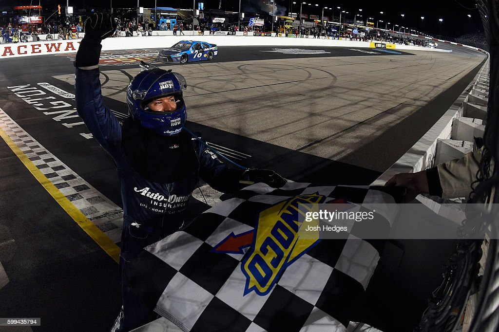 Martin Truex, Jr., driver of the #78 Auto-Owners Insurance Toyota, celebrates with the checkered flag after winning the NASCAR Sprint Cup Series Bojangles' Southern 500 at Darlington Raceway on September 4, 2016 in Darlington, South Carolina.