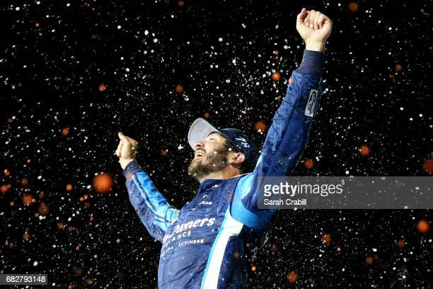 Martin Truex Jr driver of the AutoOwners Insurance Toyota celebrates in Victory Lane after winning the Monster Energy NASCAR Cup Series Go Bowling...