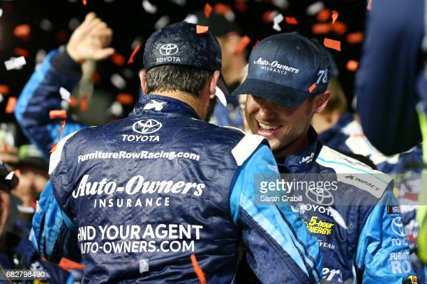 Martin Truex Jr driver of the AutoOwners Insurance Toyota celebrates with his crew in Victory Lane after winning the Monster Energy NASCAR Cup Series...