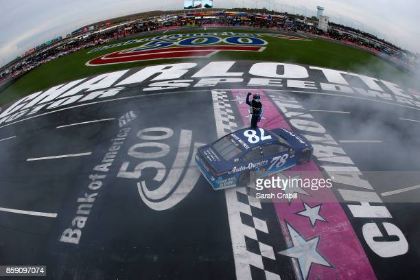 Martin Truex Jr driver of the AutoOwners Insurance Toyota celebrates after winning the Monster Energy NASCAR Cup Series Bank of America 500 at...