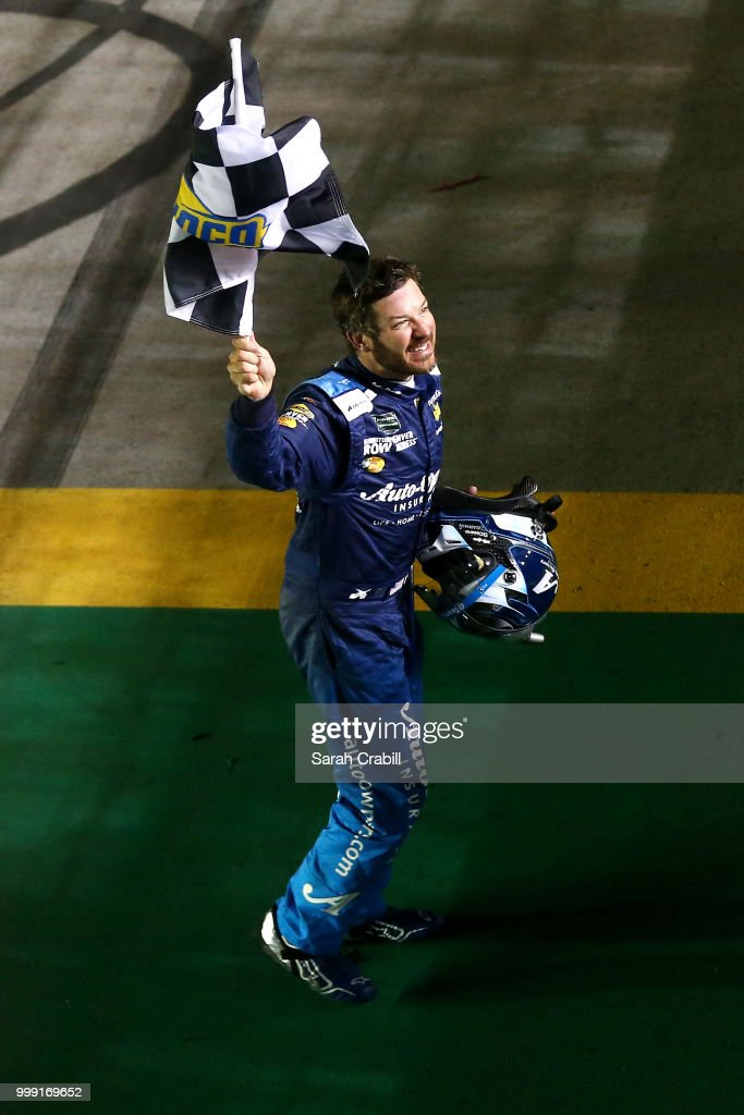 Martin Truex Jr., driver of the #78 Auto-Owners Insurance Toyota, celebrates winning the Monster Energy NASCAR Cup Series Quaker State 400 presented by Walmart at Kentucky Speedway on July 14, 2018 in Sparta, Kentucky.