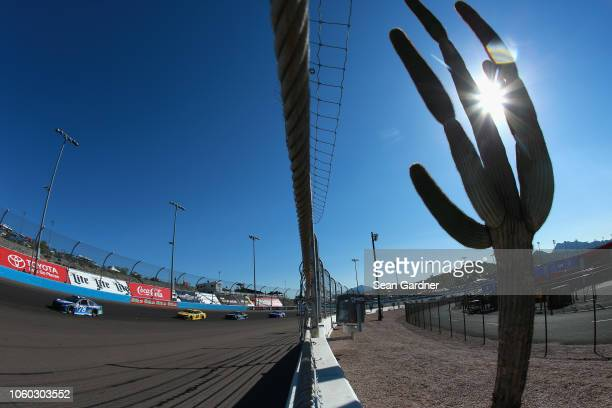 Martin Truex Jr., driver of the Auto-Owners Insurance Toyota, leads a pack of cars during the Monster Energy NASCAR Cup Series Can-Am 500 at ISM...