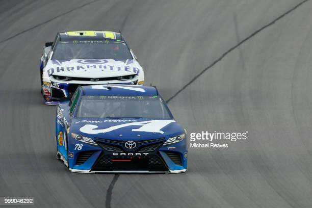 Martin Truex Jr driver of the AutoOwners Insurance Toyota leads Kasey Kahne driver of the Dark Matter presented by Ionomy Chevrolet during the...