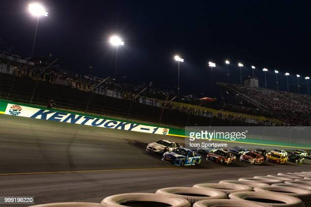 Martin Truex Jr driver of the AutoOwners Insurance Toyota leads the pack on a restart into turn one during the Monster Energy NASCAR Cup Series...