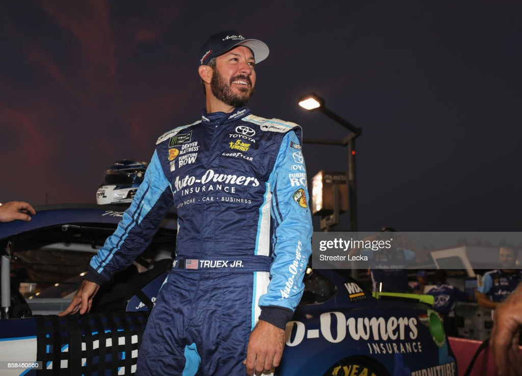 Martin Truex Jr., driver of the #78 Auto-Owners Insurance Toyota, looks on during qualifying for the Monster Energy NASCAR Cup Series Bank of America 500 at Charlotte Motor Speedway on October 6, 2017 in Charlotte, North Carolina.