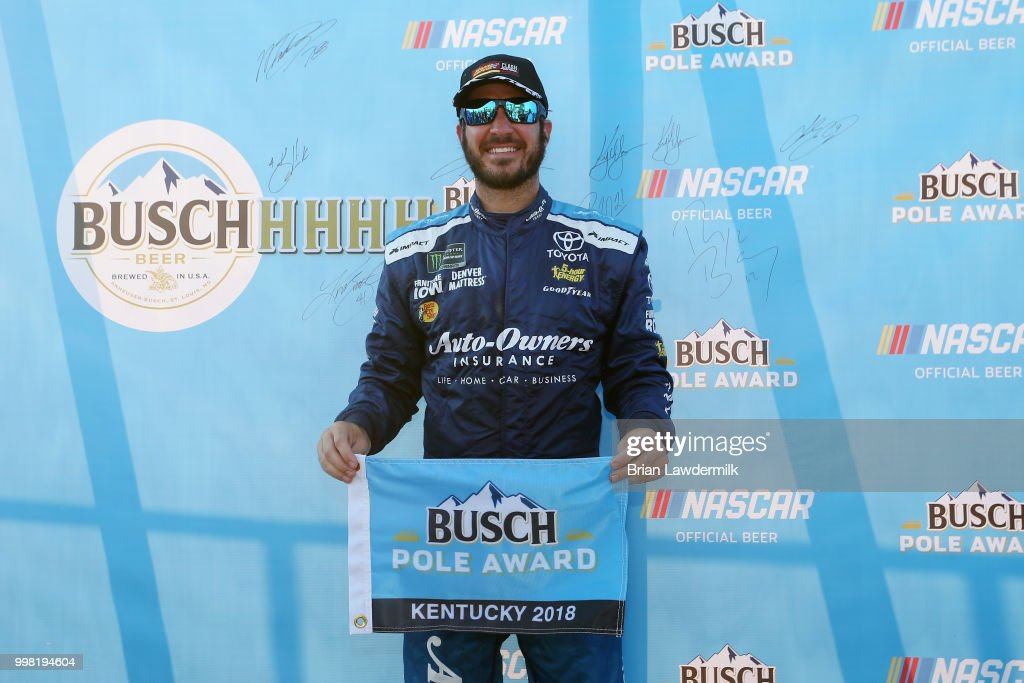 Martin Truex Jr., driver of the #78 Auto-Owners Insurance Toyota, poses with the Busch Pole Award after qualifying for the pole position for the Monster Energy NASCAR Cup Series Quaker State 400 presented by Walmart at Kentucky Speedway on July 13, 2018 in Sparta, Kentucky.