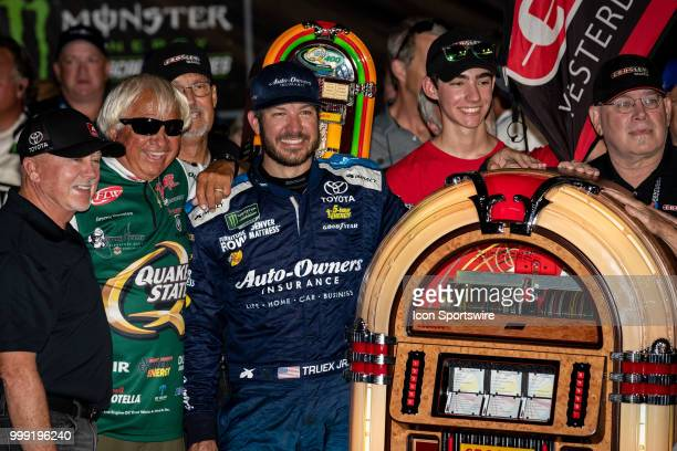 Martin Truex Jr driver of the AutoOwners Insurance Toyota poses with a Crosley jukebox he was given after winning the Monster Energy NASCAR Cup...
