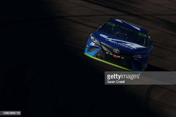 Martin Truex Jr driver of the AutoOwners Insurance Toyota races during the Monster Energy NASCAR Cup Series CanAm 500 at ISM Raceway on November 11...