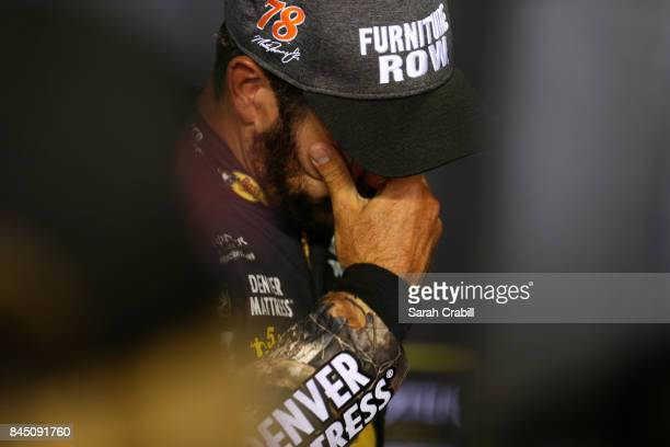 Martin Truex Jr driver of the AutoOwners Insurance Toyota reacts after the Monster Energy NASCAR Cup Series Federated Auto Parts 400 at Richmond...