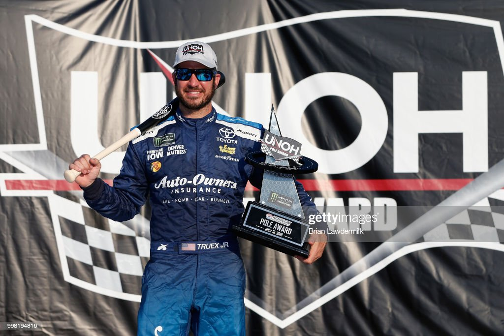 Martin Truex Jr., driver of the #78 Auto-Owners Insurance Toyota, signs the UNOH pole award after qualifying for the pole position for the Monster Energy NASCAR Cup Series Quaker State 400 presented by Walmart at Kentucky Speedway on July 13, 2018 in Sparta, Kentucky.