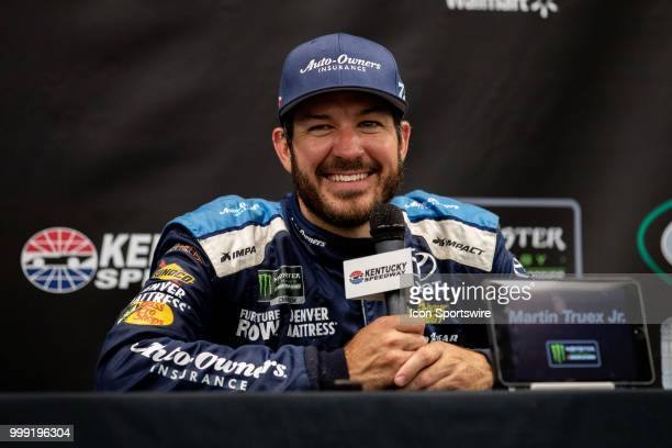 Martin Truex Jr driver of the AutoOwners Insurance Toyota smiles as he answers questions for the media after winning the Monster Energy NASCAR Cup...