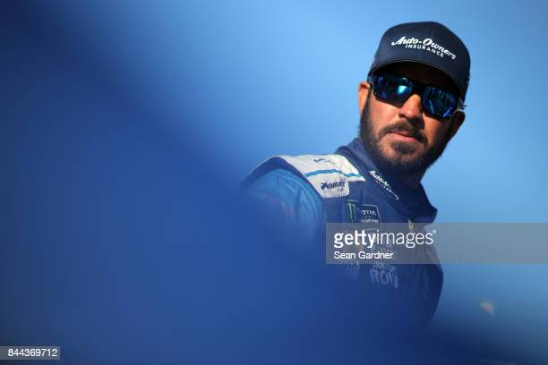 Martin Truex Jr driver of the AutoOwners Insurance Toyota stands on the grid during qualifying for the Monster Energy NASCAR Cup Series Federated...