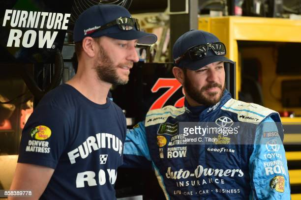 Martin Truex Jr driver of the AutoOwners Insurance Toyota talks with crew chief Cole Pearn during practice for the Monster Energy NASCAR Cup Series...