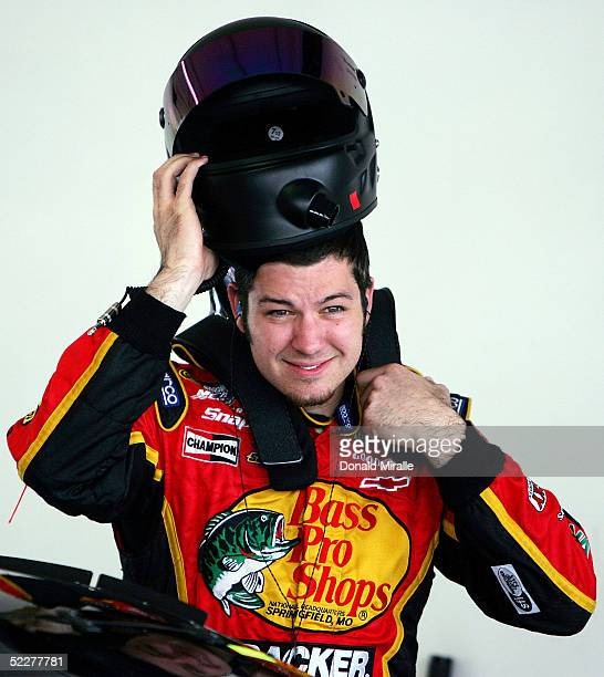 Martin Truex Jr., driver of the Bass Pro Shops Chevrolet Monte Carlo, puts on his helmet during the practice for the Telcel Mexico 200 Nascar Busch...