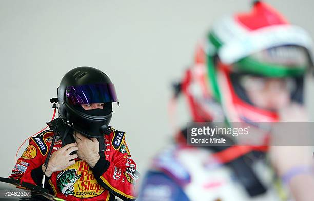 Martin Truex Jr driver of the Bass Pro Shops Chevrolet Monte Carlo puts on his helmet during the practice for the Telcel Mexico 200 Nascar Busch...