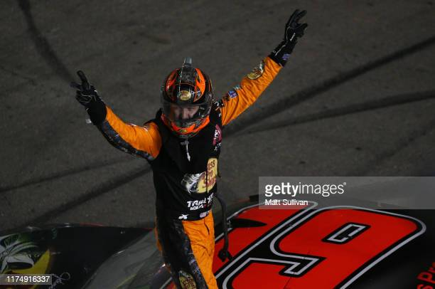 Martin Truex Jr driver of the Bass Pro Shops Toyota celebrates after winning the Monster Energy NASCAR Cup Series South Point 400 at Las Vegas Motor...