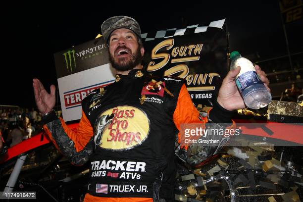 Martin Truex Jr driver of the Bass Pro Shops Toyota celebrates in victory lane after winning the Monster Energy NASCAR Cup Series South Point 400 at...