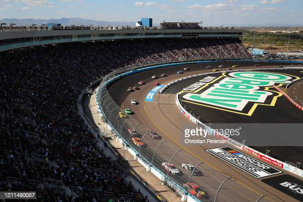 Martin Truex Jr driver of the Bass Pro Shops Toyota leads drivers during the NASCAR Cup Series FanShield 500 at Phoenix Raceway on March 08 2020 in...