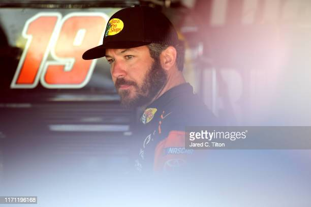 Martin Truex Jr driver of the Bass Pro Shops Toyota looks on during practice for the Monster Energy NASCAR Cup Series Bojangles' Southern 500 at...