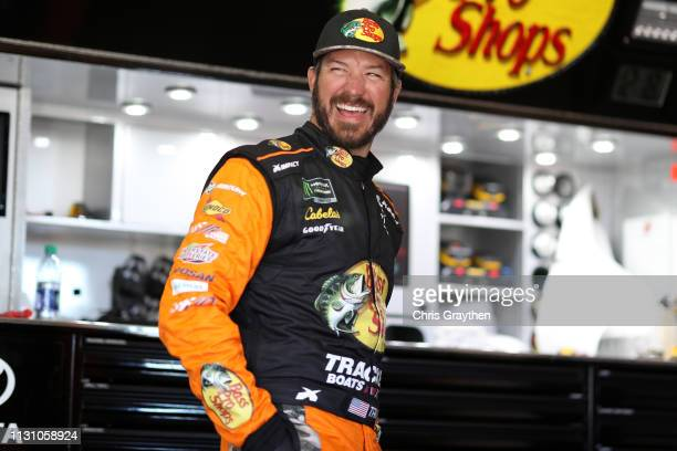 Martin Truex Jr driver of the Bass Pro Shops Toyota stands in the garage area during practice for the Monster Energy NASCAR Cup Series Auto Club 400...