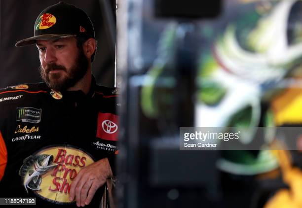 Martin Truex Jr driver of the Bass Pro Shops Toyota stands in the garage during practice for the Monster Energy NASCAR Cup Series Ford EcoBoost 400...