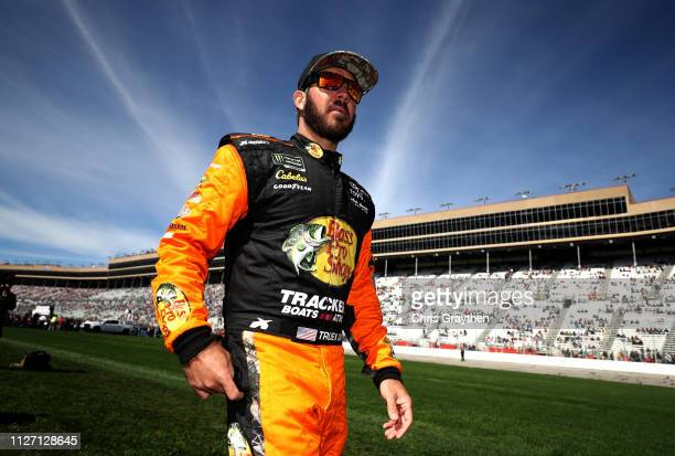 Martin Truex Jr driver of the Bass Pro Shops Toyota stands on the grid during the Monster Energy NASCAR Cup Series Folds of Honor QuikTrip 500 at...