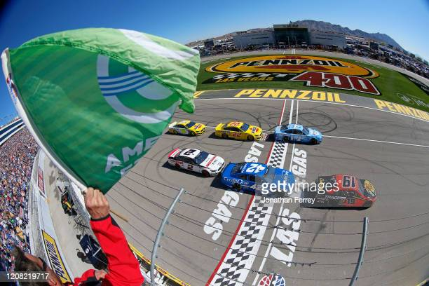 Martin Truex Jr driver of the Bass Pro Shops Toyota takes the green flag to start the NASCAR Cup Series Pennzoil 400 at Las Vegas Motor Speedway on...
