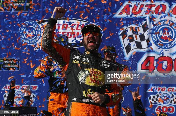 Martin Truex Jr driver of the Bass Pro Shops/5hour ENERGY Toyota celebrates in victory lane after winning the Monster Energy NASCAR Cup Series Auto...