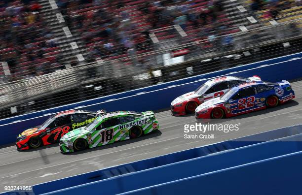Martin Truex Jr driver of the Bass Pro Shops/5hour ENERGY Toyota Kyle Busch driver of the Interstate Batteries Toyota Brad Keselowski driver of the...