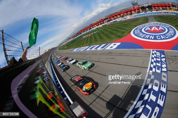 Martin Truex Jr driver of the Bass Pro Shops/5hour ENERGY Toyota leads the field to green to start the Monster Energy NASCAR Cup Series Auto Club 400...