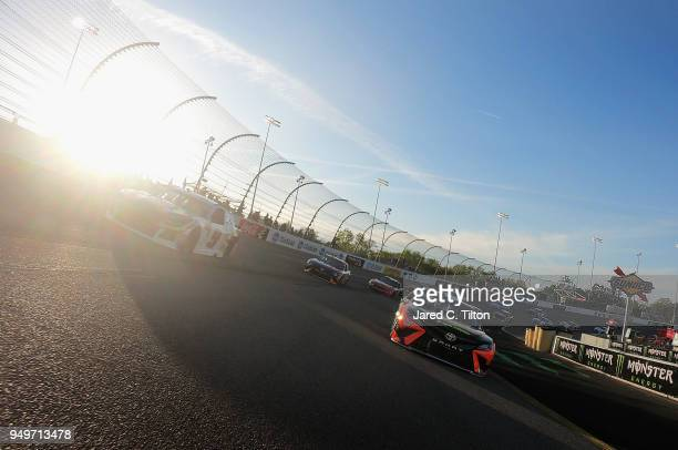Martin Truex Jr driver of the Bass Pro Shops/5hour ENERGY Toyota leads the field during a pace lap prior to the start of the Monster Energy NASCAR...