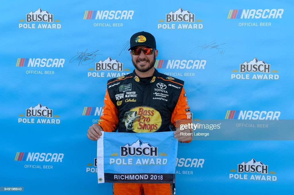Martin Truex Jr., driver of the #78 Bass Pro Shops/5-hour ENERGY Toyota, poses with the Busch Pole Award after qualifying in the pole position for the Monster Energy NASCAR Cup Series Toyota Owners 400 at Richmond Raceway on April 20, 2018 in Richmond, Virginia.