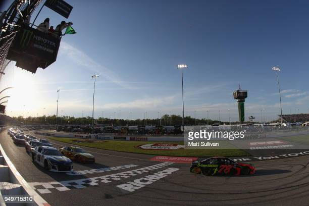 Martin Truex Jr driver of the Bass Pro Shops/5hour ENERGY Toyota takes the green flag to start the Monster Energy NASCAR Cup Series Toyota Owners 400...