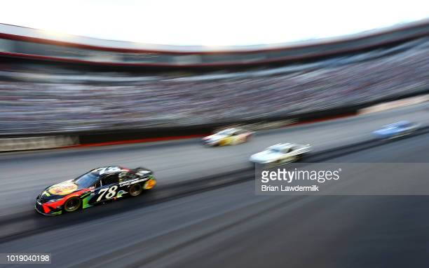 Martin Truex Jr driver of the Bass Pro Shops/Ducks Unlimited Toyota leads a pack of cars during the Monster Energy NASCAR Cup Series Bass Pro Shops...