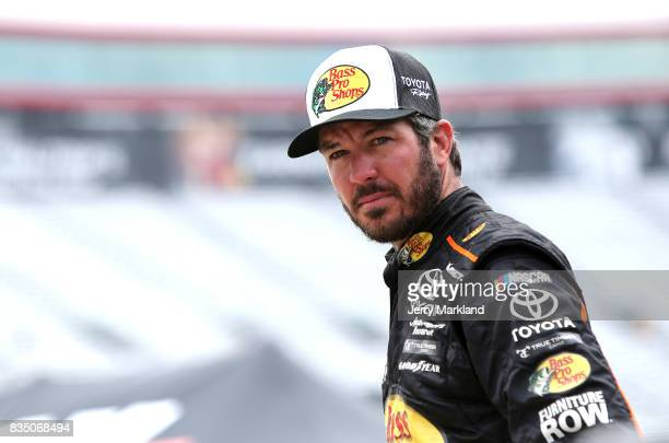 Martin Truex Jr driver of the Bass Pro Shops/Ducks Unlimited Toyota stands by his car during practice for the Monster Energy NASCAR Cup Series Bass...