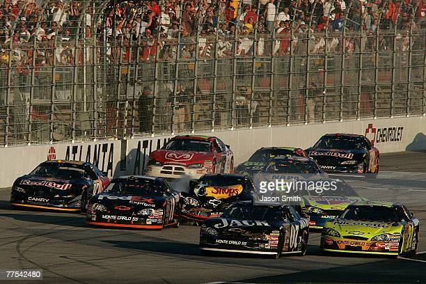 Martin Truex Jr driver of the Bass Pro Shops/Tracker Boats Chevrolet crashes in to Denny Hamlin driver of the FedEx Express Chevrolet during the...