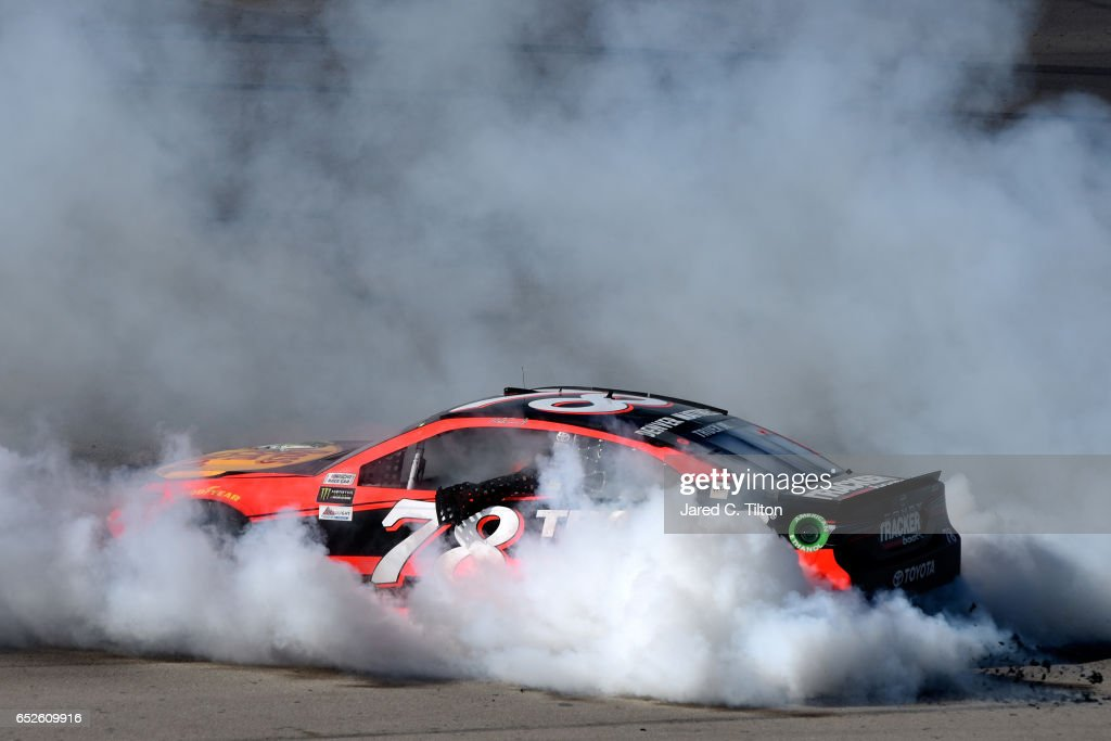 Martin Truex Jr., driver of the #78 Bass Pro Shops/TRACKER BOATS Toyota, celebrates with a burnout after winning the Monster Energy NASCAR Cup Series Kobalt 400 at Las Vegas Motor Speedway on March 12, 2017 in Las Vegas, Nevada.