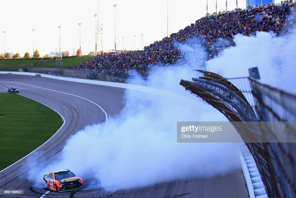 Martin Truex Jr., driver of the #78 Bass Pro Shops/Tracker Boats Toyota, celebrates with a burnout after winning the Monster Energy NASCAR Cup Series Hollywood Casino 400 at Kansas Speedway on October 22, 2017 in Kansas City, Kansas.
