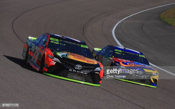 Martin Truex Jr driver of the Bass Pro Shops/Tracker Boats Toyota and Kyle Busch driver of the MM's Caramel Toyota race during the Monster Energy...