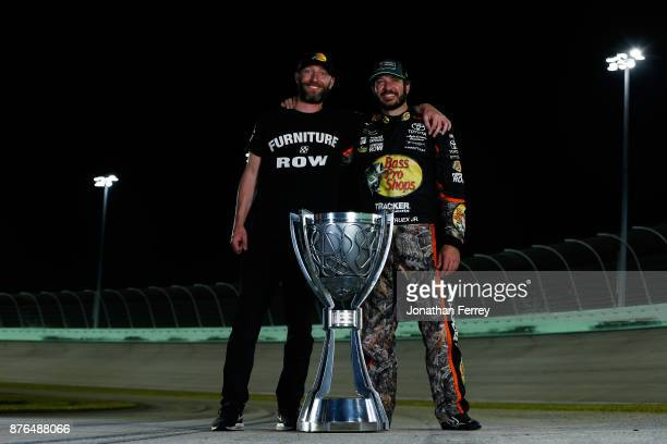 Martin Truex Jr driver of the Bass Pro Shops/Tracker Boats Toyota and his crew chief Cole Pearn pose with the Monster Energy NASCAR Cup Series...